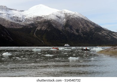 TIERRA DEL FUEGO, CHILE - NOVEMBER 19,2014: Tourists from the cruise ship landed on the shore near Pia glacier.