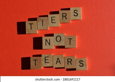 Tiers not Tears, words in wooden alphabet letters isolated on red background - Shutterstock ID 1881691117