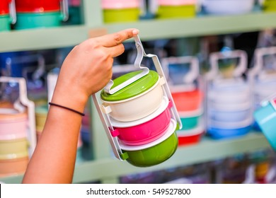 Tiffin (Food Carrier) in Colorful held by woman hand, Selective Focus