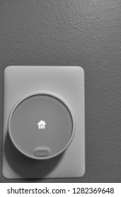 Tiffin, Iowa, USA - 2019:  Nest E thermostat on wall