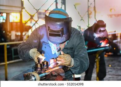 Tig welding steel pipe at workshop in factory