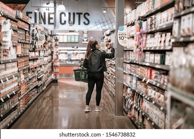 Tigard, Oregon - Oct 30, 2019 : Customer choosing grocery products on display at Whole Foods Market
