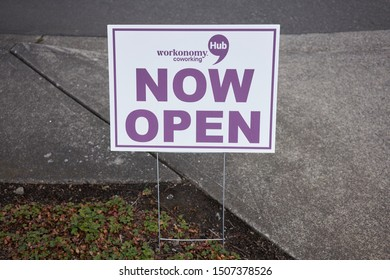 """Tigard, Oregon, USA - Sep 16, 2019: A """"Now Open"""" sign outside a new Workonomy™ Hub Coworking Space location in an Office Depot Store in Tigard, a southern suburb within the Portland metro area."""