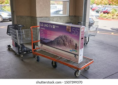 Tigard, Oregon, USA - Sep 16, 2019: An LG UHD TV featuring ThinQ AI and Google Assistant is seen on a shopping cart outside a Costco Wholesale Store in Tigard, Oregon.