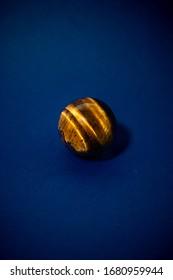 Tiger eye sphere, shiny crystal.