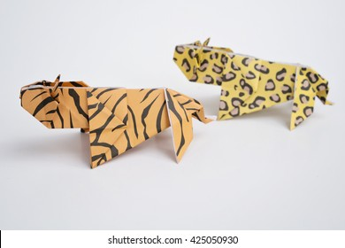 A Tiger And Leopard Origami With White Background
