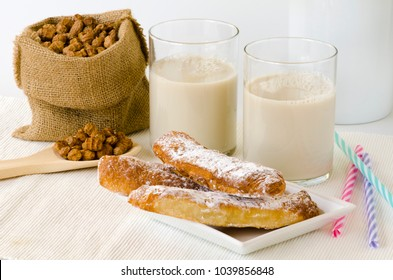 Tiger nut milk served with fartons. Refreshing cold drink from Valencia. Horchata de chufa.