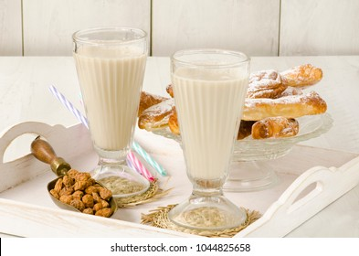 Tiger nut milk served with fartons, typical sweet from Valencia. Horchata de chufa.