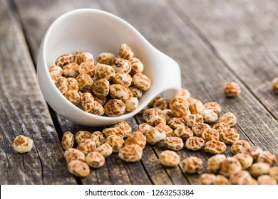 Tiger nuts. Tasty chufa nuts. Healthy superfood on old wooden table.