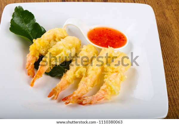Tiger prawn tempura with green sauce on wood backgrond