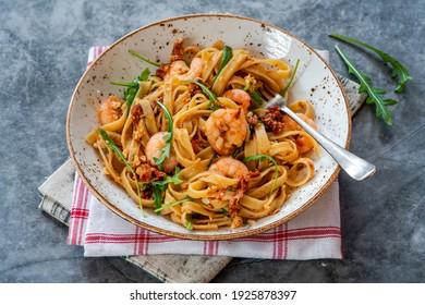 Tiger prawns in tomato, chilli and almond pesto with fettuccine pasta