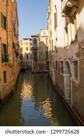Tight canal between the buildings, Venice, Italy | Photo of a public street.