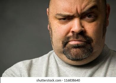 Tight crop of serious man's face