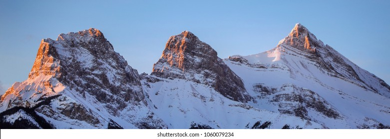 A tight panorama of the Three Sisters being hit my the first rays of the morning sunrise.