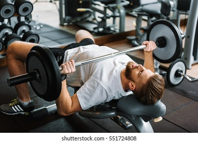 Tight powerful man in gym