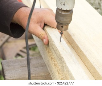 Tightening the screws on the board