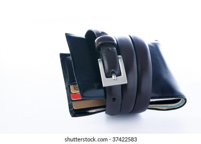 Tightening the wallet with a belt over white background.