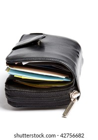 Tightly filled black leather wallet of a businessman