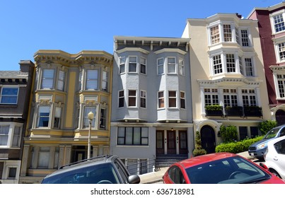 Tightly packed bright colorful houses on steep streets in San Francisco California