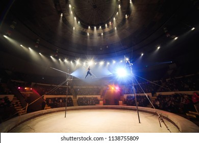 Tightrope walkers at the circus.