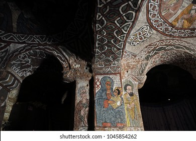 TIGRAY REGION, ETHIOPIA – February 10, 2018: wall murals of saints and iconographic scenes, painted in naive african christian style, on wall of Abuna Yemata Guh church