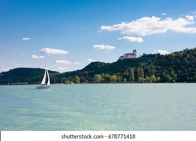 Tihany Abbey  and a sailboat from Lake Balaton in Hungary