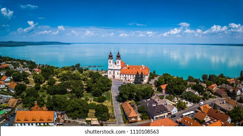 Tihany, Hungary - Aerial panoramic view of the famous Benedictine Monastery of Tihany (Tihany Abbey) with beautiful colourful Lake Balaton at background