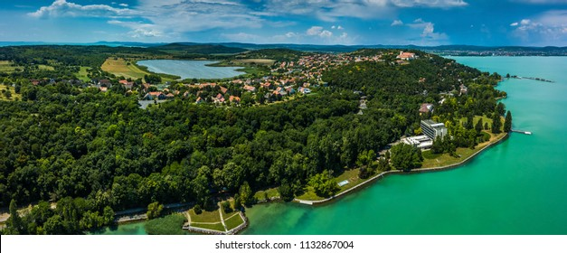 Tihany, Hungary - Aerial panoramic view of Lake Balaton with the Benedictine Monastery (Tihany Abbey, Tihanyi Apatsag) on top of the hill. This view includes the Inner lake and the harbour of Tihany