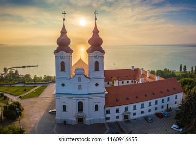 Tihany, Hungary - Aerial panoramic view of Benedictine Monastery of Tihany (Tihany Abbey) at sunrise with Lake Balaton at background