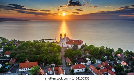 Tihany, Hungary - Aerial skyline view of the famous Benedictine Monastery of Tihany (Tihany Abbey) with beautiful colourful sky and clouds at sunrise over Lake Balaton
