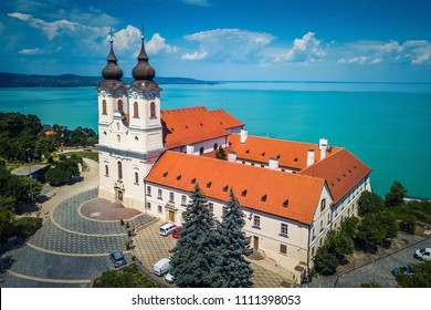 Tihany, Hungary - Aerial view of the famous Benedictine Monastery of Tihany (Tihany Abbey) with beautiful coloruful Lake Balaton and blue sky at background