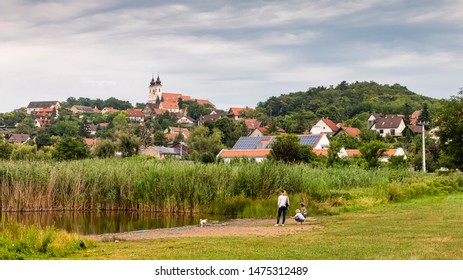 TIHANY, HUNGARY - JULY 28, 2019: The Benedictine Abbey and the old village are seen from the Inner lake (in Hungarian: Belső tó) on July 28, 2019 in Tihany, Hungary.