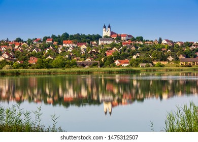 TIHANY, HUNGARY - JULY 30, 2019: The Benedictine Abbey and the old village are seen from the Inner lake (in Hungarian: Belső tó) on July 30, 2019 in Tihany, Hungary.