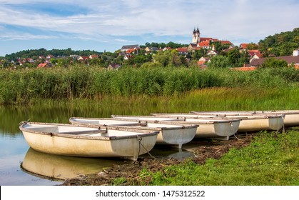 TIHANY, HUNGARY - JULY 30, 2019: Rowing boats are tied up at the Inner lake (in Hungarian: Belső tó) on July 30, 2019 in Tihany, Hungary.