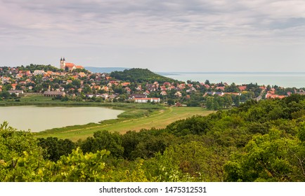 TIHANY, HUNGARY - JULY 30, 2019: The Benedictine Abbey and the old village are seen between the Inner lake (in Hungarian: Belső tó) (l) and the Lake Balaton (r) on July 30, 2019 in Tihany, Hungary.