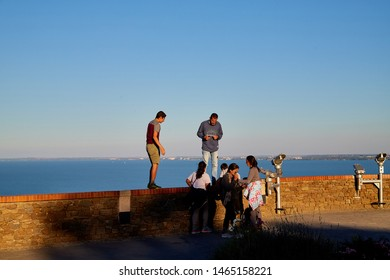 Tihany, Hungary - September 27, 2018: View of the Lake Balaton from Tihany on a sunny day. Tourists on the high shore of lake Balaton at sunset