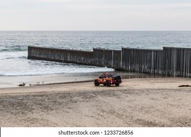 TIJUANA, BAJA CALIFORNIA, MEXICO - OCTOBER 22, 2018:  A lifeguard vehicles waits on the beach at the western end point of the international border wall between Tijuana and San Diego, California.
