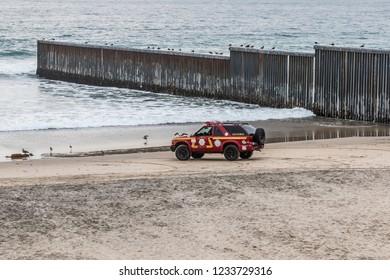 TIJUANA, BAJA CALIFORNIA, MEXICO - OCTOBER 22, 2018:  A lifeguard vehicles waits on the beach on the southern side of the international border wall between Tijuana and San Diego, California.
