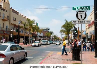 TIJUANA, BAJA CALIFORNIA/MEXICO - JUNE 20, 2018:  People walk along Avenida Revolucion, the city's main thoroughfare and a popular destination for Americans traveling south of the San Diego border.