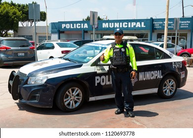 TIJUANA, BAJA CALIFORNIA/MEXICO - JUNE 20, 2018:  A police officer gives the thumbs-up in front of a police station near the downtown area.