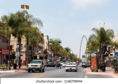 TIJUANA, BAJA CALIFORNIA/MEXICO - JUNE 20, 2018:  Traffic along Avenida Revolucion, the main thoroughfare of the city, with a view of the landmark Monumental/Millennial Arch (Arco y Reloj Monumental).
