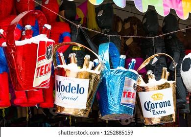 TIJUANA, BAJA CALIFORNIA/MEXICO - JUNE 20, 2018:  Pinatas shaped as buckets of beer hang in an outdoor market.