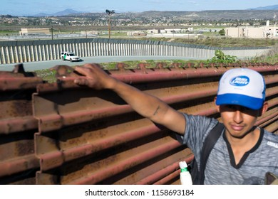 Tijuana, Mexico, 25 march 2018. Near the border the wall with USA is a fence 2 meter high. Migrants try to cross every day