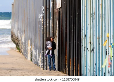 Tijuana, Mexico, 25 march 2018.  Near the border the wall with USA is a fence 2 meter high.  Migrants try to cross every day. On sunday relatives meets each other at the international friendship park