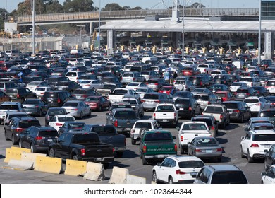 TIJUANA, MEXICO - FEBRUARY 8, 2018: Weekday commuters continue to endure long lines at the Tijuana/San Ysidro border crossing with wait times often lasting two hours or more.