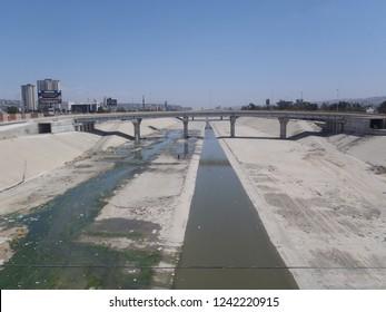 Tijuana, Mexico - May 14 2013 : Bridge over dry concrete canal near Mexican-American border zone
