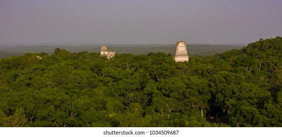 TIKAL, GUATEMALA - AUGUST 10, 2008: Temples and jungle canopy, at the Mayan ruins of Tikal, located  in El Peten department, Tikal National Park.