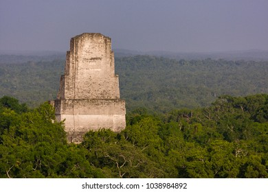 TIKAL, GUATEMALA - AUGUST 10, 2008: Temple III and jungle canopy, at the Mayan ruins of Tikal, located  in El Peten department, Tikal National Park.