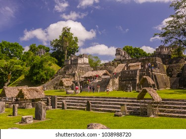 TIKAL, GUATEMALA - AUGUST 11, 2008: Tourists at the North Acropolis, in the Grand Plaza, at the Mayan ruins of Tikal, located  in the El Peten department, Tikal National Park.