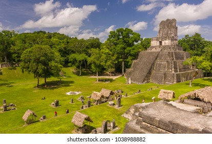 TIKAL, GUATEMALA - AUGUST 11, 2008: Temple II, in the Grand Plaza, at the Mayan ruins of Tikal, located  in El Peten department, Tikal National Park.